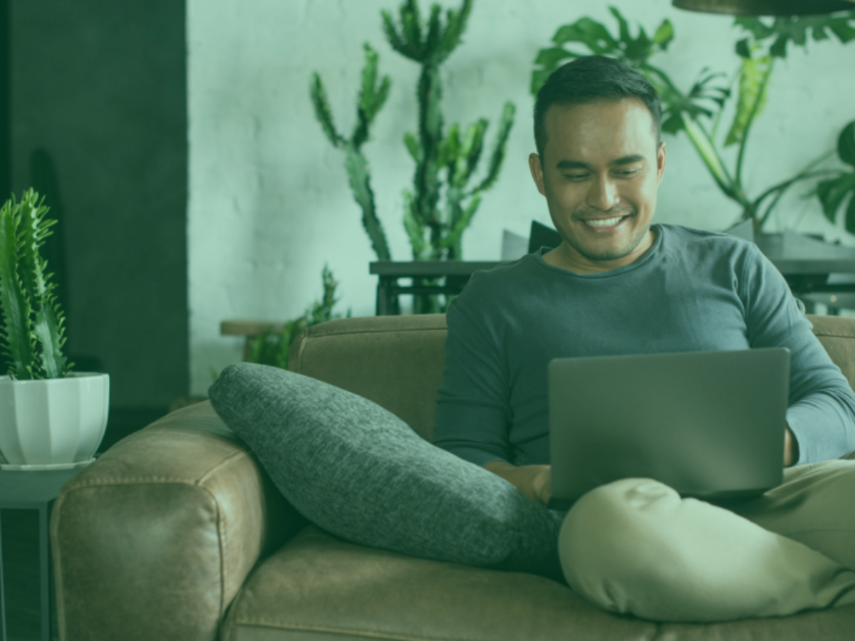man on laptop surrounded by plants